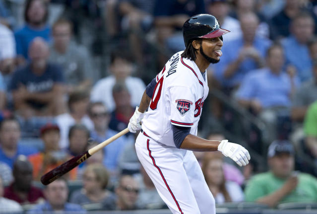 Atlanta Braves starting pitcher Ervin Santana (30) reacts after striking out in the third inning of a baseball game against the Los Angeles Dodgers Wednesday, Aug. 13, 2014, in Atlanta. (AP Photo/John Bazemore)