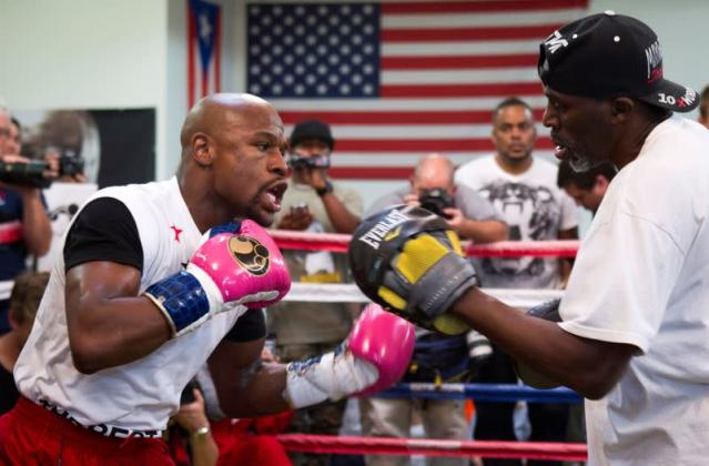 FILE PHOTO: WBC welterweight champion Floyd Mayweather Jr. of the U.S. works on his timing with his uncle and trainer Roger Mayweather at the Mayweather Boxing Club in Las Vegas, Nevada