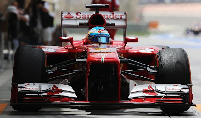 SAKHIR, BAHRAIN - APRIL 19: Fernando Alonso of Spain and Ferrari exits his garage to drive during practice for the Bahrain Formula One Grand Prix at the Bahrain International Circuit on April 19, 2013 in Sakhir, Bahrain. (Photo by Mark Thompson/Getty Images)