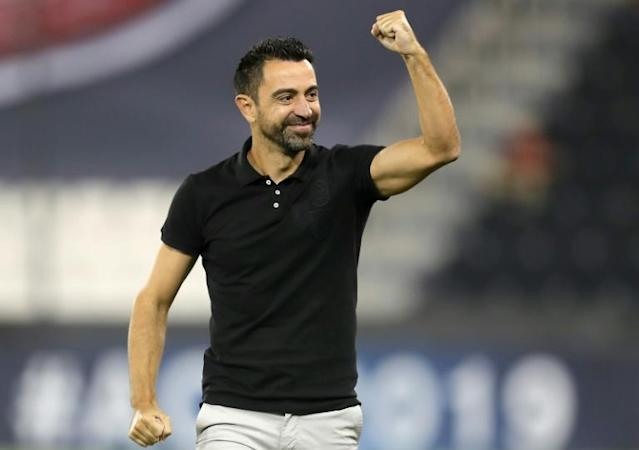Al Sadd's Spanish coach Xavi Hernandez celebrated as his team scored on its way to victory over Al Duhail in the Asian Champions League (AFP Photo/KARIM JAAFAR)