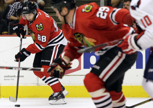 Chicago Blackhawks' Patrick Kane (88) controls the puck during the second period of an NHL preseason hockey game against the Washington Capitals in Chicago, Saturday, Sept. 28, 2013. (AP Photo/Nam Y. Huh)