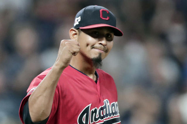 FILE - In this Sept. 20, 2019, file photo, Cleveland Indians relief pitcher Carlos Carrasco pumps his fist after the Indians defeated the Philadelphia Phillies 5-2 in a baseball game in Cleveland. Carrasco was selected as the 2019 Roberto Clemente Award winner, given annually by Major League Baseball to honor sportsmanship and community involvement, the league announced Friday, Oct. 5, 2019. (AP Photo/Tony Dejak, File)