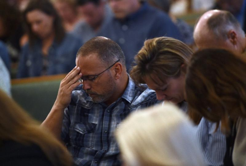 Worshippers attend a May 20, 2018, mass at Arcadia First Baptist Church in memory of the Santa Fe High School shooting victims in Texas (AFP Photo/Brendan SMIALOWSKI)