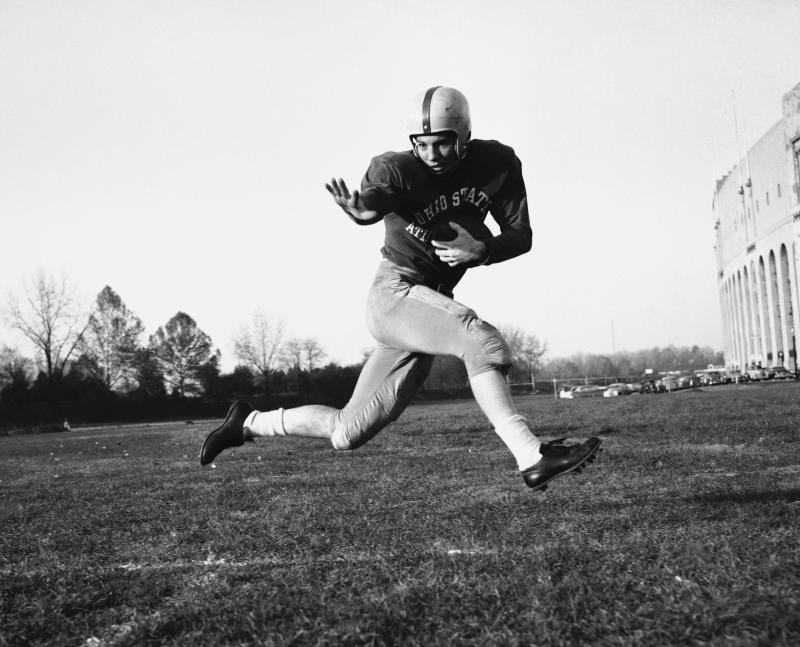 "FILE - This is a 1953 file photo showing Ohio State halfback Howard ""Hopalong"" Cassady. In the history of college football, only 44 schools have been able to make the claim ""We're No. 1"" and have The Associated Press poll back up the boast. Ohio State has the most No. 1 rankings. (AP Photo/Harold Valentine, File)"