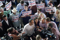 Texas Land Commissioner George P. Bush, center, talks with the media at a kick-off rally where he announced he will run for Texas Attorney General, Wednesday, June 2, 2021, in Austin, Texas. (AP Photo/Eric Gay)