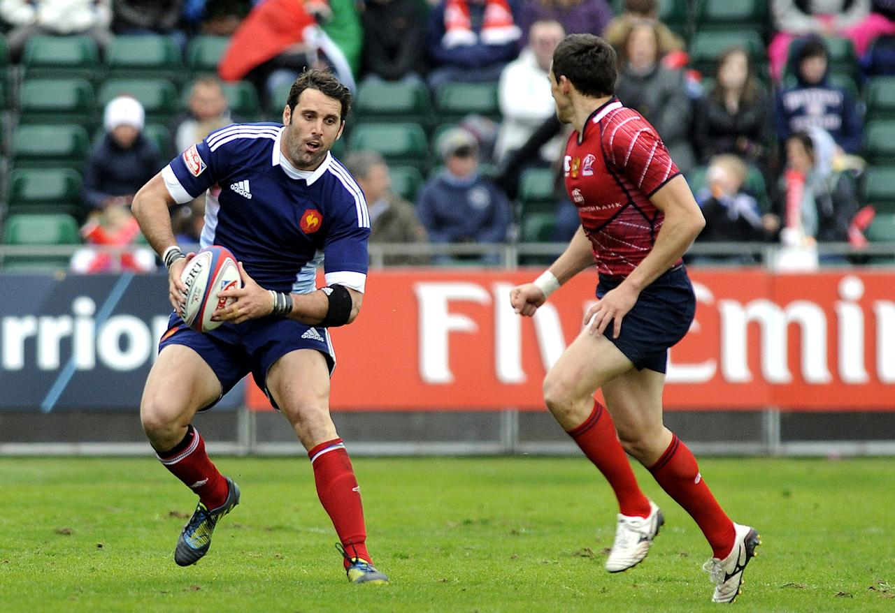 Jean Baptiste Gobelet (L) of France runs with the ball against Russia during their Rugby Union Glasgow Sevens game at Scotstoun Stadium in Glasgow, Scotland, on May 4, 2013. France won the game 15-14. AFP PHOTO/ANDY BUCHANANAndy Buchanan/AFP/Getty Images