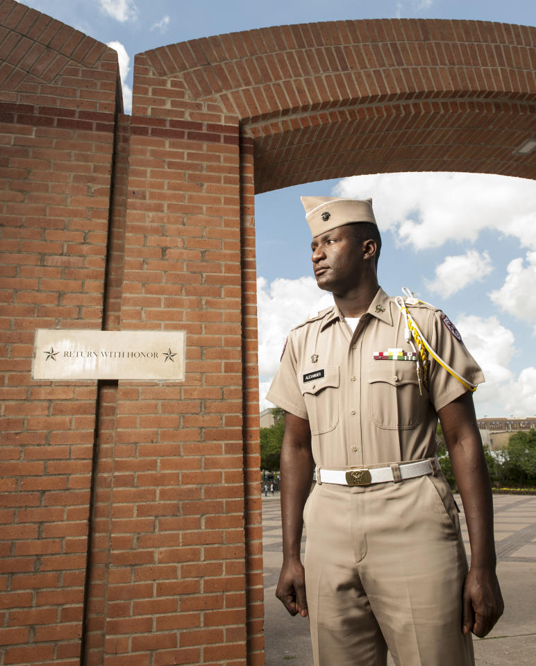 Texas A&M junior Marquis Alexander poses for a photograph by the Corps Arches, the entry point to the Corps of Cadets residence halls, on the A&M campus, Wednesday, April 11, 2012, in College Station, Texas. Alexander has been appointed to Corps Commander, the top leadership position for the A&M Corps of Cadets, for the next year. (AP Photo/Dave Einsel)