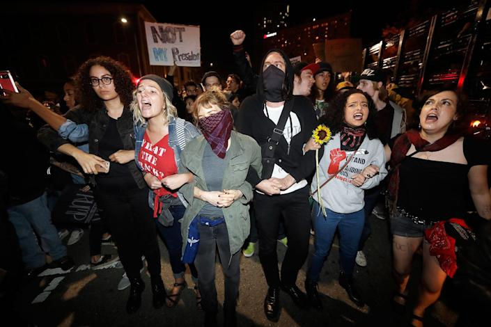 <p>Protesters shout at police Wednesday, Nov. 9, 2016, in Oakland, Calif. Police in Oakland blocked thousands of people protesting Donald Trump's election from getting onto a highway Wednesday night. The crowd chanting and waving signs gathered in Frank Ogawa Plaza in downtown Oakland in the afternoon. (Photo: Marcio Jose Sanchez/AP) </p>