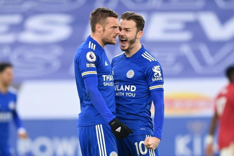 Fox in the box: Jamie Vardy's (left)shot deflected in off Axel Tuanzebe to earn Leicester a 2-2 draw with Manchester United