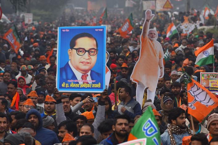 A BJP supporter holds up an image of B.R Ambedkar during a rally for Indian Prime Minister Narendra Modi on December 22, 2019 in New Delhi, India. | Sanchit Khanna/Hindustan Times via Getty Images—2019 Hindustan Times