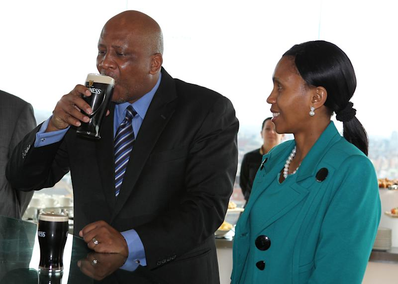 King Letsie III of Lesotho (L) tastes a pint of Guinness as his wife Queen Masenate Mohato Seeiso looks on during their visit to the Guinness Storehouse in Dublin, Ireland, on May 22, 2012. King Letsie III of Lesotho and Queen Masenate Mohato Seeiso are on a three-day official visit to Ireland. AFP PHOTO/ PETER MUHLY (Photo credit should read PETER MUHLY/AFP/GettyImages)
