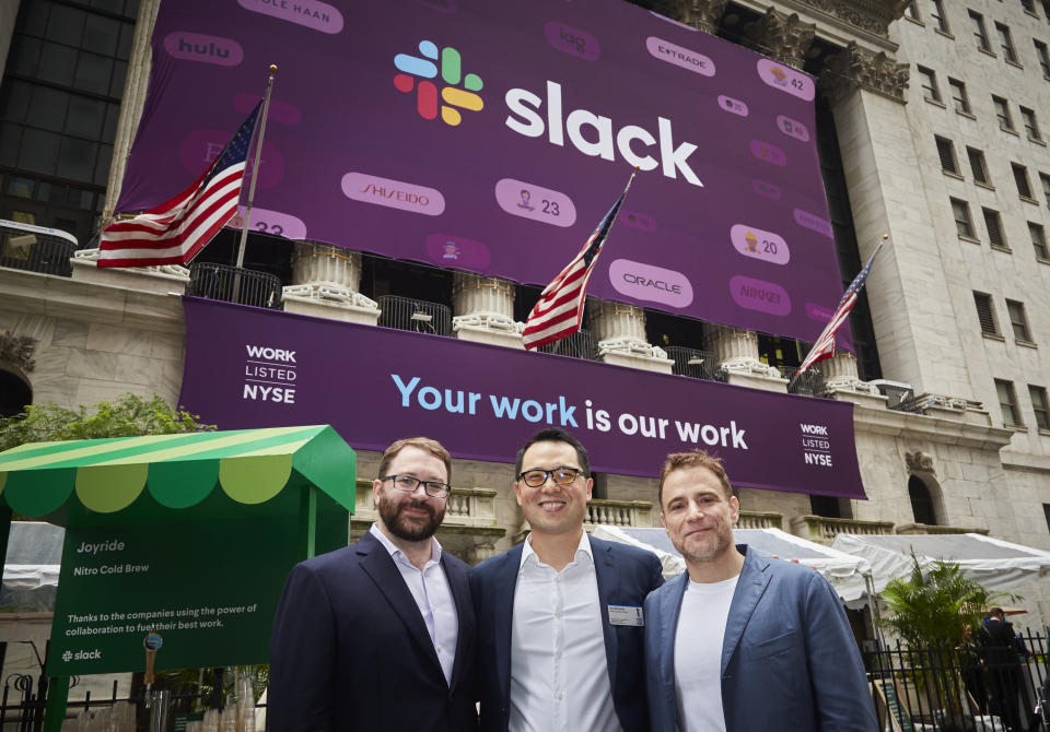 Cal Henderson, Allen Shim, and Stewart Butterfield standing in front of the NYSE