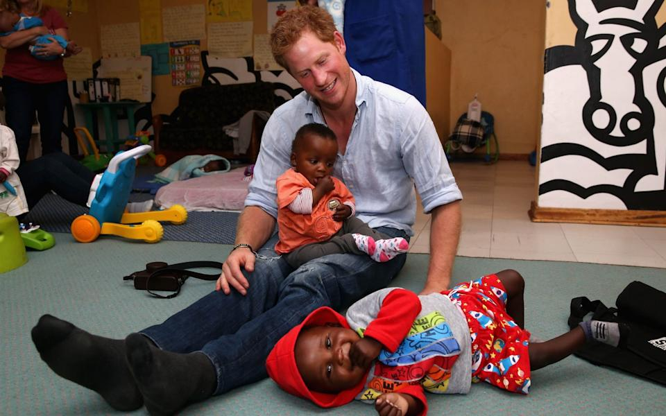 Prince Harry during a visit to Sentebale in 2014 - ITV