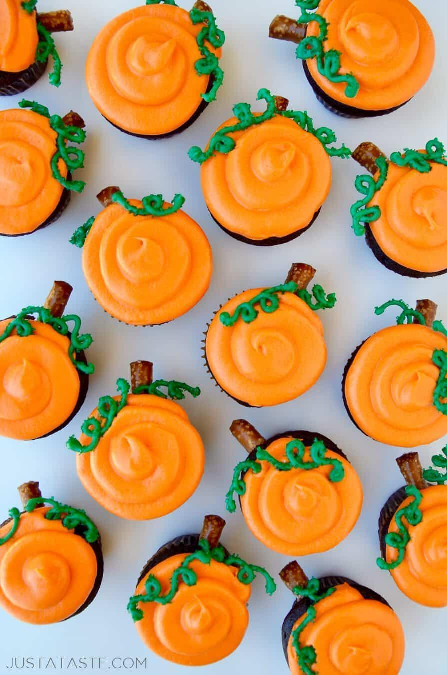 """<p>The dense, fudgy cake recipe used here pairs beautifully with the sweet cream cheese frosting layered on top. The pumpkin design is also way easier than it looks.</p><p><strong>Get the recipe at <a href=""""https://www.justataste.com/chocolate-halloween-cupcakes-cream-cheese-frosting-recipe/"""" rel=""""nofollow noopener"""" target=""""_blank"""" data-ylk=""""slk:Just a Taste"""" class=""""link rapid-noclick-resp"""">Just a Taste</a>.</strong></p><p><strong><a class=""""link rapid-noclick-resp"""" href=""""https://go.redirectingat.com?id=74968X1596630&url=https%3A%2F%2Fwww.walmart.com%2Fbrowse%2Fhome%2Fbakeware%2Fthe-pioneer-woman%2F4044_623679_8455465&sref=https%3A%2F%2Fwww.thepioneerwoman.com%2Ffood-cooking%2Fmeals-menus%2Fg32110899%2Fbest-halloween-desserts%2F"""" rel=""""nofollow noopener"""" target=""""_blank"""" data-ylk=""""slk:SHOP BAKEWARE"""">SHOP BAKEWARE</a><br></strong></p>"""