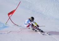 Switzerland's Lara Gut-Behrami powers pasta gate on her way to win a women's giant slalom, at the alpine ski World Championships in Cortina d'Ampezzo, Italy, Thursday, Feb. 18, 2021. (AP Photo/Giovanni Auletta)