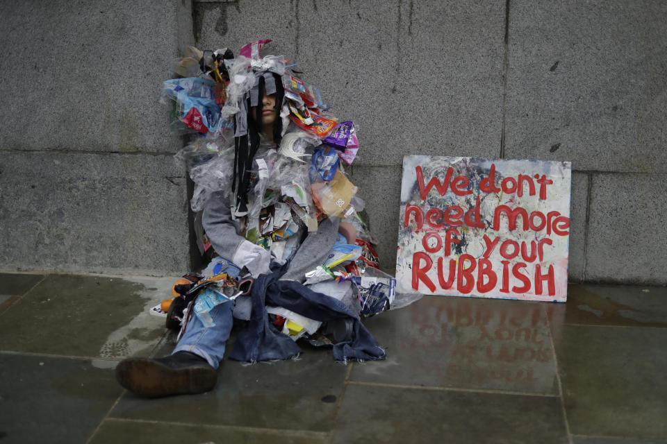 A climate protestors sits outside Britain's Parliament in central London Monday, Oct. 7, 2019. Extinction Rebellion movement blocked major roads in London, Berlin and Amsterdam on Monday at the beginning of what was billed as a wide-ranging series of protests demanding new climate policies. (AP Photo/Matt Dunham)