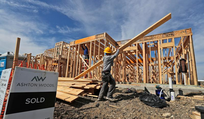 In this Wednesday, Feb. 20, 2019, photo a construction crew works on an already sold new home in north Dallas. On Tuesday, March 5, the Commerce Department reports on sales of new homes in December. AP Photo/LM Otero)