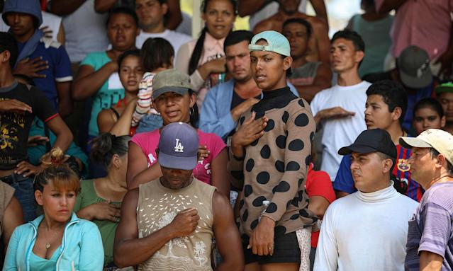 "<p>Central American migrants from Honduras sing their national anthem during the annual Migrant Stations of the Cross caravan or ""Via crucis,"" organized by the ""Pueblo Sin Fronteras"" activist group, as the group makes a few-days stop in Matias Romero, Oaxaca state, Mexico, Monday, April 2, 2018. (Photo: Felix Marquez/AP) </p>"