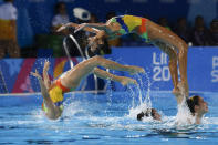 Members of Cuba's artistic swimming team compete in the free routine event at the Pan American Games in Lima, Peru, Wednesday, July 31, 2019. (AP Photo/Moises Castillo)