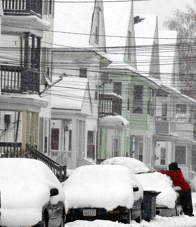 A man clears off his car during a winter storm in Lawrence, Mass. Tuesday, March 19, 2013. Winter went out with a blast in the Northeast on Tuesday, snow and sleet delaying the start of school in some areas and making the morning commute an icy, slippery mess a day before spring starts. The nasty weather led some schools in upstate New York, Massachusetts and Connecticut to close, adding a few more snow days to school calendars. (AP Photo/Winslow Townson)