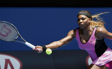 Serena Williams of the U.S. hits a return to Vesna Dolonc of Serbia during their women's singles match at the Australian Open 2014 tennis tournament in Melbourne January 15, 2014. REUTERS/Jason Reed