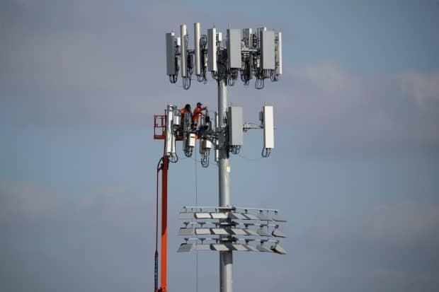 A system used in the United States that helps increase competition and keep wireless prices down involves allowing smaller service providers to buy wholesale access to the cellphone networks owned by larger companies.