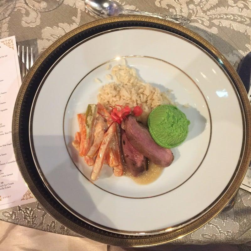<p>Roast duck, applesauce, green pea timbale, creamed carrots, rice pilaf</p> <p>(other options: lamb with mint sauce and sirloin of beef with red wine demi)</p>