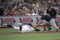 Tampa Bay Rays' Avisail Garcia (24) safely dives under the tag of Boston Red Sox shortstop Xander Bogaerts (2) after Joey Wendle flied out to left field during the third inning of a baseball game Friday, Sept. 20, 2019, in St. Petersburg, Fla. (AP Photo/Phelan M. Ebenhack)