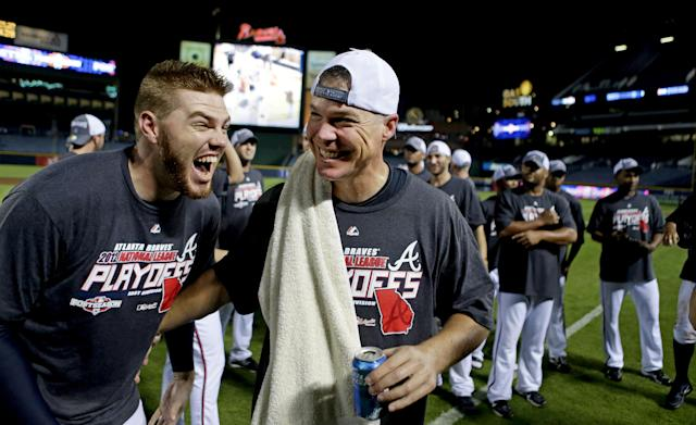 Atlanta Braves' Chipper Jones, right, celebrates with teammate Freddie Freeman after the Braves beat the Miami Marlins 4-3 in a baseball game to clinch the wild card Tuesday, Sept. 25, 2012, in Atlanta. (AP Photo/David Goldman)