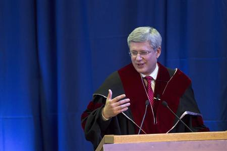 Canada's Prime Minister Harper speaks after he was awarded a honorary Doctor of Philosophy degree from Tel Aviv University