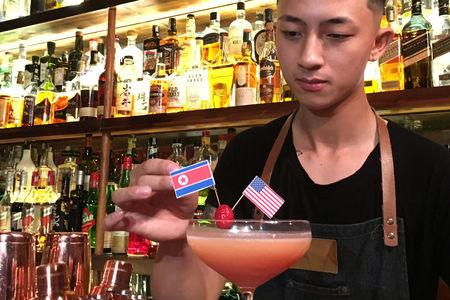 A bartender makes a cocktail to commemorate a US-DPRK summit in Hanoi, Vietnam February 20, 2019. REUTERS/Mai Nguyen