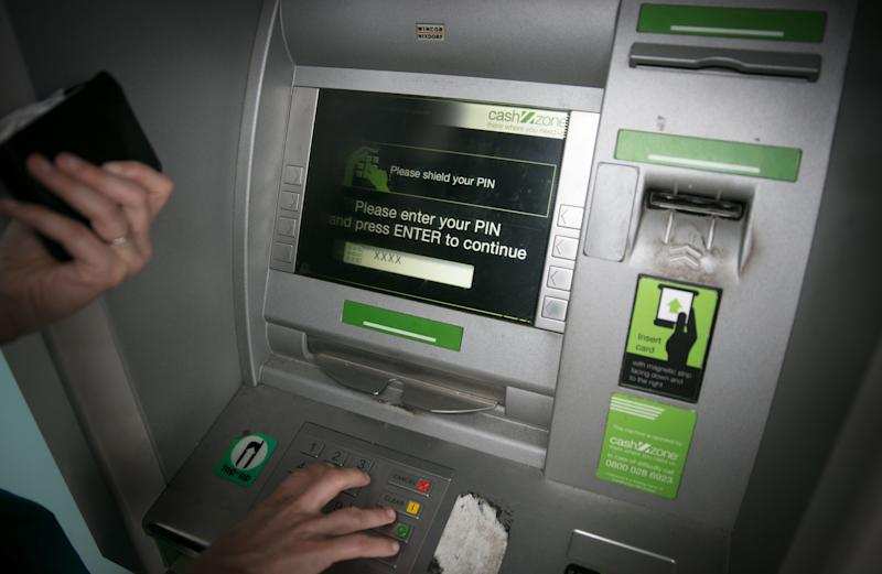 BRISTOL, ENGLAND - NOVEMBER 03: In this photo illustration a woman uses a cashpoint ATM on November 3, 2017 in Bristol, England. The Bank of England raised interest rates from a historic low for the first time in ten years this week raising costs of lending and concerns for householder debt. (Photo by Matt Cardy/Getty Images)