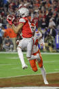 FILE - In this Saturday, Dec. 28, 2019, file photo, Ohio State wide receiver Chris Olave catches a touchdown pass in front of Clemson safety Nolan Turner during the second half of the Fiesta Bowl NCAA college football game in Glendale, Ariz. Ohio State hosts Nebraska on Saturday, Oct. 24, 2020. (AP Photo/Rick Scuteri, File)