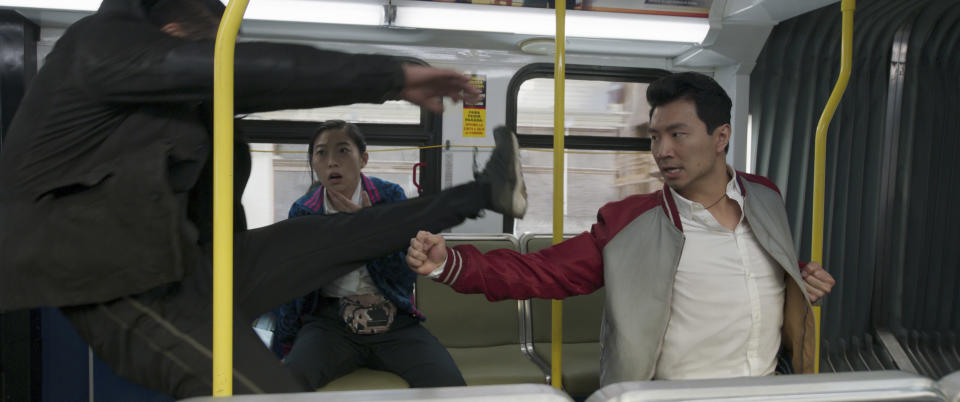 """This image released by Marvel Studios shows Awkwafina and Simu Liu in a scene from """"Shang-Chi and the Legend of the Ten Rings."""" (Marvel Studios via AP)"""