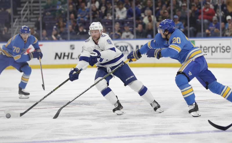 Tampa Bay Lightning's Steven Stamkos (91) tries to skate past the outstretched stick of St. Louis Blues' Alexander Steen (20) in the first period of an NHL hockey game, Saturday, March 23, 2019, in St. Louis. (AP Photo/Tom Gannam)