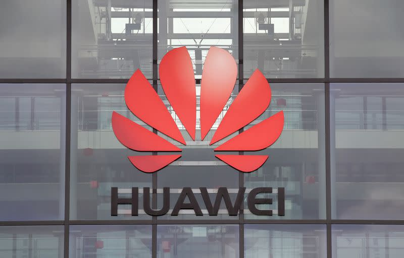 China says it will act to protect its interests after UK Huawei ban