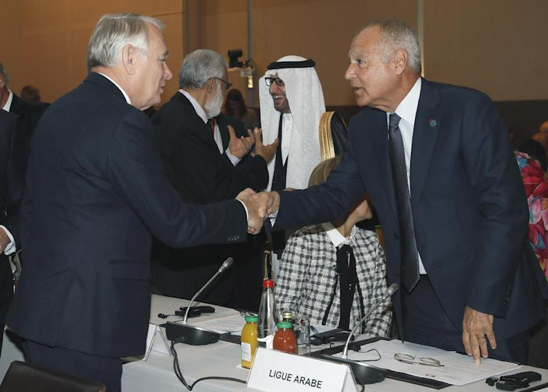 French Minister of Foreign Affairs Jean-Marc Ayrault, left, shakes hands with Arab League Secretary General Ahmed Aboul-Gheit at the opening of the Mideast peace conference in Paris, Sunday, Jan. 15, 2017. Fearing a new eruption of violence in the Middle East, more than 70 world diplomats gathered in Paris on Sunday to push for renewed peace talks that would lead to a Palestinian state. (Thomas Samson/Pool Photo via AP)