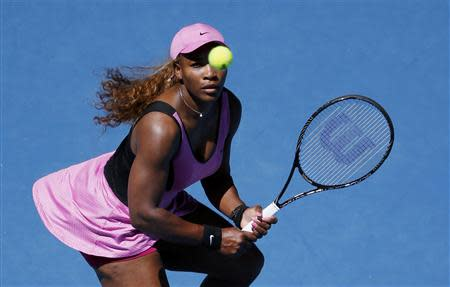 Serena Williams of the U.S. eyes the ball during her women's singles match against Daniela Hantuchova of Slovakia at the Australian Open 2014 tennis tournament in Melbourne January 17, 2014. REUTERS/Jason Reed