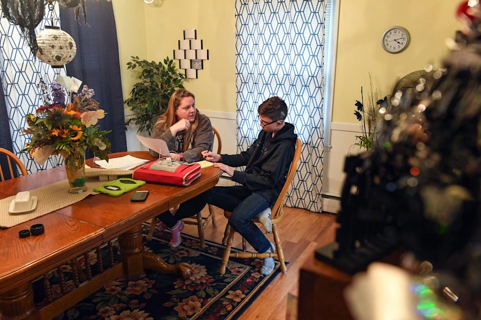 Shawna Diedrich helps her son, Trey Diedrich, study for a math test last fall at their home in Mitchell, South Dakota. Even though the test was on content Trey said he learned the previous year, he said he did not understand how to do some of the problems.