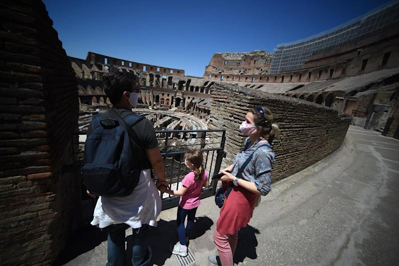 Visitors view the Colosseum monument in Rome (AFP via Getty Images)