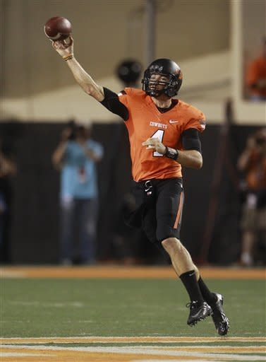 Oklahoma State quarterback J.W. Walsh passes against Texas in the first quarter of an NCAA college football game in Stillwater, Okla., Saturday, Sept. 29, 2012. (AP Photo/Sue Ogrocki)