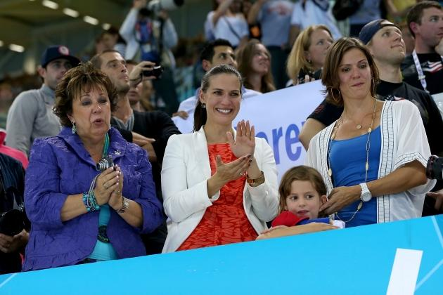 Mother of gold medallist Michael Phelps of the United States, Debbie Phelps(L) and his sisters Hilary (C) and Whitney (R) watch the medal ceremony for the Men's 4x100m medley Relay Final on Day 8 of the London 2012 Olympic Games at the Aquatics Centre on August 4, 2012 -- Getty Images