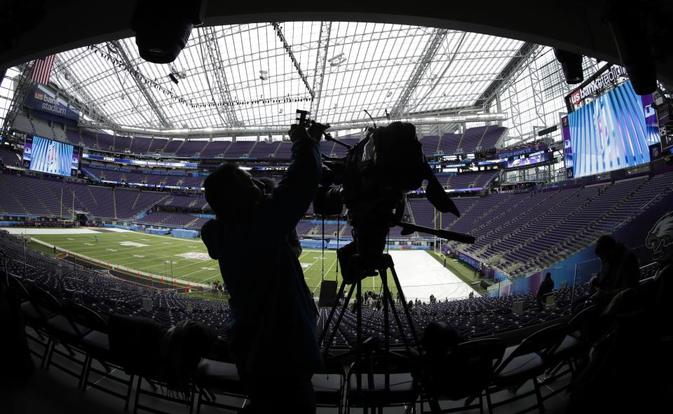A videographer shoots video of U.S. Bank Stadium as workers get it ready for Super Bowl LI on Tuesday, Jan. 30, 2018, in Minneapolis. (AP)