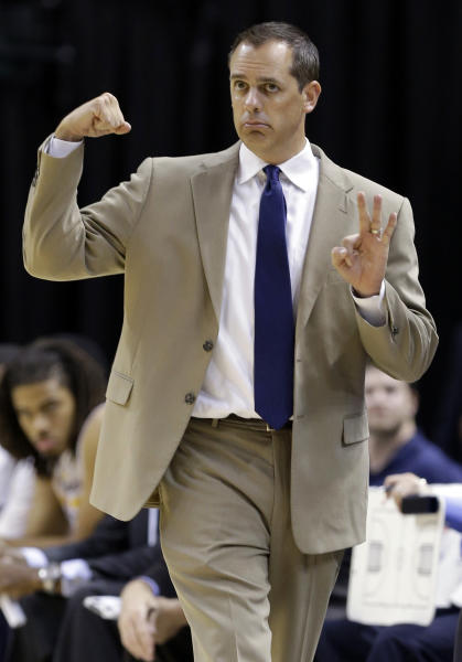 Indiana Pacers head coach Frank Vogel calls a play for his team in the first half of an NBA preseason basketball game against the Chicago Bulls in Indianapolis, Saturday, Oct. 5, 2013. (AP Photo/Michael Conroy)