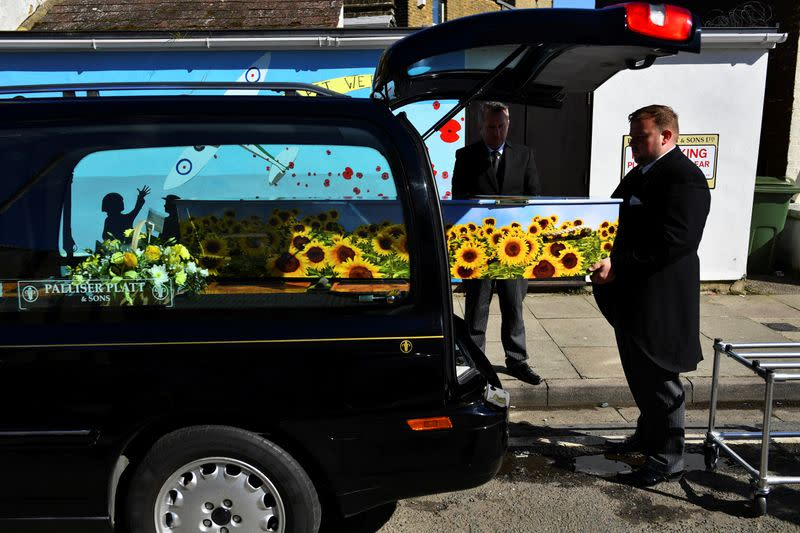 Pall bearers in Sheerness carry the coffin of a person who died after contracting COVID-19, on the Isle of Sheppey