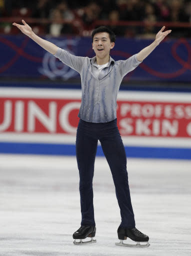 U.S. Vincent Zhou celebrates after performing during mens's short program at the Figure Skating World Championships in Assago, near Milan, Thursday, March 22, 2018. (AP Photo/Luca Bruno)