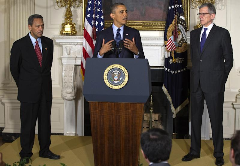 President Barack Obama announces his nominees for the Federal Communications Commission (FCC), Tom Wheeler, right, and Federal Housing Finance Authority (FHFA) Director Rep. Melvin Watt, D.C., Wednesday, May 1, 2013, in the State Dining of the White House in Washington. (AP Photo/Jacquelyn Martin)