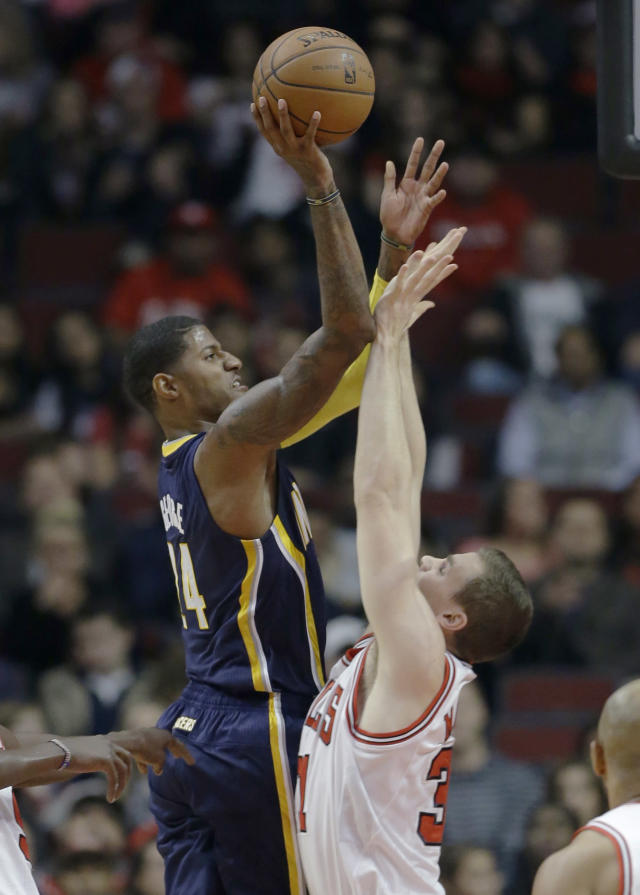 Indiana Pacers guard Paul George (24), left, shoots over Chicago Bulls forward Erik Murphy (31) during the first half of an NBA preseason basketball game in Chicago on Friday, Oct. 18, 2013. (AP Photo/Nam Y. Huh)