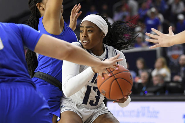 Rice guard Erica Ogwumike (13) fights through the defense of Middle Tennessee forward Jordan Majors, left, in the second half of an NCAA college basketball game in the championship game of the Conference USA women's tournament, Saturday, March 16, 2019, in Frisco, Texas. Rice won 69-54. (AP Photo/Jeffrey McWhorter)