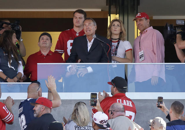Former San Francisco 49ers receiver Dwight Clark, center (in dark jacket), died on Monday after a three-year battle with ALS. He was 61 years old. (AP)